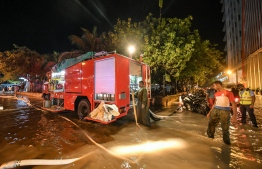 Maldives National Defence Force's Fire and Rescue Services pumping water from a flooded street in Male' on November 5. PHOTO: NISHAN ALI/MIHAARU
