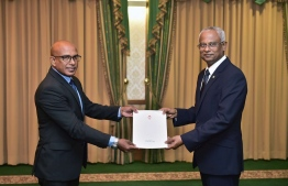 Jumhooree Party (JP)'s Secretary General Ahmed Sameer, receiving his letter of appointment as a Minister at the President's Office. PHOTO: PRESIDENT'S OFFICE