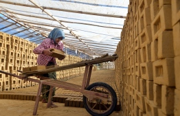 This photo taken on December 5, 2018 shows Myanmar woman working in a brick factory in Naypyidaw. (Photo by Thet AUNG / AFP)