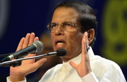 Sri Lanka's President Maithripala Sirisena attends the special Sri Lanka Freedom Party (SLFP) convention in Colombo on December 04, 2018.  (Photo by LAKRUWAN WANNIARACHCHI / AFP)