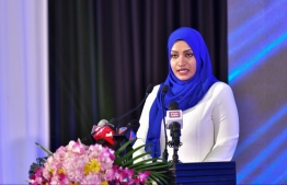 Transport Minister Aishath Nahula addresses Friday's ceremony. PHOTO: HUSSAIN WAHEED/MIHAARU
