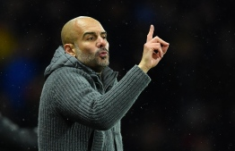 Manchester City's Spanish manager Pep Guardiola shouts instructions to his players from the touchline during the English Premier League football match between Watford and Manchester City at Vicarage Road Stadium in Watford, north of London. PHOTO: BEN STANSALL / AFP