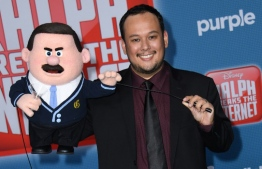 """(FILES) In this file photo taken on November 5, 2018 animator Raymond S. Persi arrives for the Disney premiere of """"Ralph Breaks The Internet"""" at El Capitan theatre in Hollywood. - Disney's """"Ralph Breaks the Internet"""" has again topped North American box offices, taking in an estimated $16.1 million for the weekend to narrowly edge out another family-oriented animation, Universal's """"The Grinch,"""" industry tracker Exhibitor Relations said December 9, 2018. On a last quiet weekend before the coming crush of holiday films, the order of the top five films on this three-day weekend was, remarkably, exactly the same as last weekend. (Photo by VALERIE MACON / AFP)"""