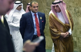 Saudi Foreign Minister Adel al-Jubeir (R) escorts Yemen's Deputy Foreign Minister Mohammed Hadrami (C) as they arrive to attend a meeting of foreign ministers of countries from seven Arab and African states surrounding the Red Sea and the Gulf of Aden, in the Saudi capital Riyadh on December 12, 2018. (Photo by FAYEZ NURELDINE / AFP)