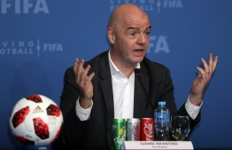 FIFA President Gianni Infantino speaks during a press conference in the Qatar capital, Doha on December 13, 2018. (Photo by KARIM JAAFAR / AFP)
