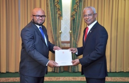 President Ibrahim Mohamed Solih (R) awards letter of appointment to Ali Nazeer, State Minister for Home Affairs. PHOTO/PRESIDENT'S OFFICE