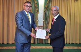 President Ibrahim Mohamed Solih (R) awards letter of appointment to Ahmed Adhil, State Minister for Transport. PHOTO/PRESIDENT'S OFFICE