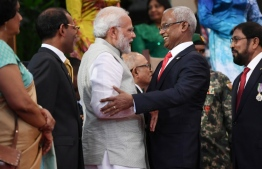 President Ibrahim Mohamed Solih welcomes Indian Prime Minister Narendra Modi during the former's swearing-in ceremony. PHOTO: AFP