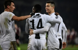 (From L) Juventus' Croatian forward Mario Mandzukic, Juventus' French midfielder Blaise Matuidi and Juventus' Portuguese forward Cristiano Ronaldo celebrate at the end of the Italian Serie A football match Torino vs Juventus on December 15, 2018 at the Olympic stadium in Turin. (Photo by Marco BERTORELLO / AFP)