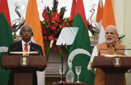 Maldives President Ibrahim Mohamed Solih (L) listens as India Prime Minister Narendra Modi (R) delivers his speech during a ceremony in New Delhi on December 17, 2018. - Maldivian President is on three-day of state visit to India till December 18. (Photo by Prakash SINGH / AFP)