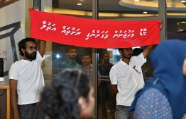 "ruling faces a demonstration initiated by political movement 'Navaanavai' calling to free the parliament from the influence of business magnates. Banner reads ""Recover the islands stolen by magnates""  PHOTO: NISHAN ALI/MIHAARU"