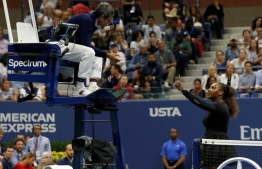"(FILES) In this file photo taken on September 8, 2018 Serena Williams of the US argues with chair umpire Carlos Ramos while playing Naomi Osaka of Japan during their 2018 US Open women's singles final match  in New York. - Osaka, 20, triumphed 6-2, 6-4 in the match marred by Williams's second set outburst, the American enraged by umpire Carlos Ramos's warning for receiving coaching from her box. She tearfully accused him of being a ""thief"" and demanded an apology from the official. (Photo by Eduardo MUNOZ ALVAREZ / AFP)"