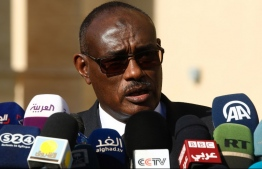 Sudanese Foreign Minister Al-Dierdiry Ahmed delivers a speech to the media following a meeting with Sudan's President in the capital Khartoum on December 27, 2018. - Egypt's foreign minister and intelligence chief are in Sudan for talks with government officials facing deadly protests and calls for President Omar al-Bashir to step down over price hikes. (Photo by ASHRAF SHAZLY / AFP)