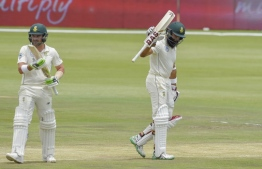South Africa's Hashim Amla reacts after scoring his fifty runs during day three of the 1st cricket test match between South Africa and Pakistan at SuperSport Park cricket stadium on December 28, 2018 in Pretoria. (Photo by Christiaan Kotze / AFP)