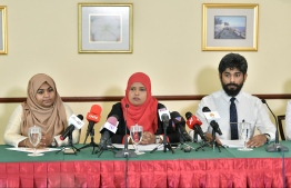 Gender Minister Shidhatha Shareef (C) speaks at a press briefing. PHOTO: HUSSAIN WAHEED / MIHAARU