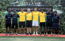 Tim Cahill, son Kyah Cahill and the rest of the coaching staff pose for a picture following the conclusion of the football camp. PHOTO: HAWWA AMANY ABDULLA/THE EDITION