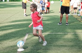 Children of different ages took part in the interactive football training camp hosted by AmillaFushi and Australian footballer Tim Cahill. PHOTO: HAWWA AMANY ABDULLA / THE EDITION