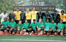 Tim Cahill alongside his coaching staff and festival camp officials pose for a photo during the closing ceremony of the camp. PHOTO: HAWWA AMANY ABDULLA/THE EDITION