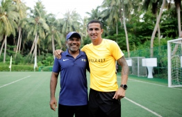 Tim Cahill poses with local coach Ahmed Shareef (Dunga) after the day's festivities. PHOTO: HAWWA AMANY ABDULLA