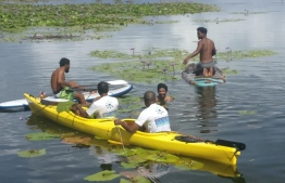 Members of One Fuvahmulah assessing the state of Bandaara Kilhi, one of two freshwater bodies in the island, threatened by an invasive foreign species of plant. PHOTO: ONE FUVAHMULAH / FACEBOOK