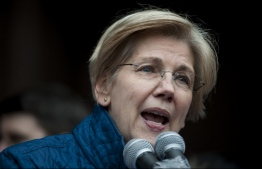 (FILES) In this file photo taken on January 29, 2017 US Senator Elizabeth Warren, D-MA, speaks to people gathered at Copley Square in Boston, Massachusetts to decry US President Donald Trump's sweeping executive order, which restricts refugees and travellers from seven Muslim-majority countries. - Democratic Senator Elizabeth Warren -- a fierce critic of Donald Trump -- on December 31, 2018 took a major step towards a likely run for president, seeking to upset the incumbent Republican in 2020. The 69-year-old Warren, who has represented Massachusetts in the Senate since 2013, is a progressive Democrat. She said she was launching an exploratory committee for president, which would help her raise funds early in the campaign cycle. (Photo by Ryan McBride / AFP)