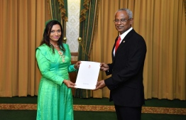 Newly appointed State Minister for Gender, Family and Social Services Ifham Hussain with President Solih. PHOTO: PRESIDENT'S OFFICE