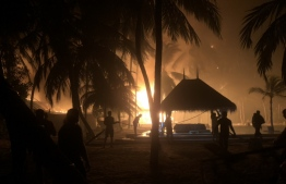 Fire rescuers and Gili Lankan Fushi staff working to control the fire.