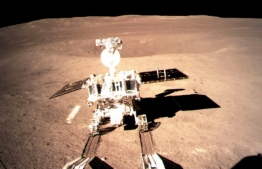 """This picture taken on January 3, 2019 and received on January 4 from the China National Space Administration (CNSA) via CNS shows a robotic lunar rover on the """"dark side"""" of the moon. - A Chinese lunar rover landed on the far side of the moon on January 3, in a global first that boosts Beijing's ambitions to become a space superpower. (Photo by China National Space Administration (CNSA) via CNS / China National Space Administration (CNSA) via CNS / AFP) /"""