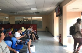 Passengers in the waiting area of Hanimaadhoo Airport. PHOTO/MIHAARU