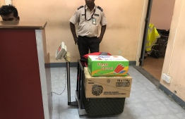 Luggage weighed on a simple scale at Hanimaadhoo Airport. PHOTO/MIHAARU