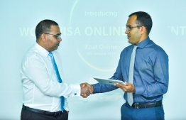 Minister of Communications Science and Technology Mohamed Maleeh Jamaal integrates the online portal for work VISA fees. PHOTO: AHMED NISHAATH/MIHAARU
