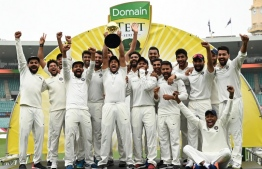 India's team celebrate their series win on the fifth day of the fourth and final cricket Test against Australia at the Sydney Cricket Ground in Sydney on January 7, 2019. (Photo by PETER PARKS / AFP) /