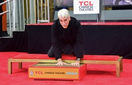 Actor Sam Elliott places his hands in the block of cement during his Hand and Footprints ceremony in Hollywood, California on January 7, 2019. Frederic J. BROWN / AFP