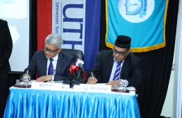 CEO of MI College Ahmed Motakee and Chancellor of UTHM Dr Waheed Bin Razalee signing the agreement. PHOTO: MIHAARU