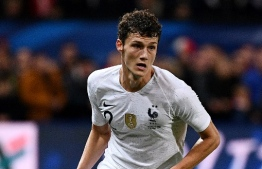 (FILES) In this file photo taken on October 11, 2018, France's defender Benjamin Pavard plays the ball during the friendly football match between France and Iceland at the Roudourou Stadium in Guingamp, western France. - As German first division Bundesliga football club FC Bayern Munich announced on January 9, 2019, Pavard has signed a five-years-contract with the German record masters. (Photo by FRANCK FIFE / AFP)