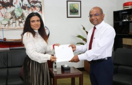 Minister of Foreign Affairs Abdulla Shahid presents the exequatur to Mariyam Waheeda. PHOTO: MINSITRY OF FOREIGN AFFAIRS