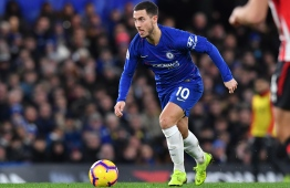 Chelsea's Belgian midfielder Eden Hazard runs with the ball during the English Premier League football match between Chelsea and Southampton at Stamford Bridge in London on January 2, 2019. (Photo by Ben STANSALL / AFP) / RESTRICTED TO EDITORIAL USE. No use with unauthorized audio, video, data, fixture lists, club/league logos or 'live' services. Online in-match use limited to 120 images. An additional 40 images may be used in extra time. No video emulation. Social media in-match use limited to 120 images. An additional 40 images may be used in extra time. No use in betting publications, games or single club/league/player publications. /