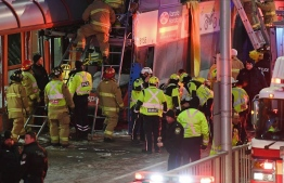 Police and first responders work at the scene where a double-decker city bus struck a transit shelter in Ottawa, on Friday, Jan. 11, 2019.Justin Tang / THE CANADIAN PRESS