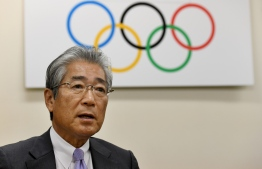 "(FILES) This file photo taken on January 19, 2018 shows Japanese Olympic Committee president Tsunekazu Takeda speaking during an interview with AFP at his office in Tokyo. - The head of Japan's Olympic Committee has been indicted in Paris for ""active corruption"" in connection with the awarding of the 2020 Olympics to Tokyo, a French judicial source said on January 11, 2019. (Photo by Toshifumi KITAMURA / AFP)"
