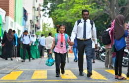 A child goes to school on the first day of the 2019 Academic Year. PHOTO: HUSSAIN WAHEED/ MIHAARU