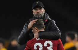 Liverpool's German manager Jurgen Klopp consoles Liverpool's Swiss midfielder Xherdan Shaqiri following the English FA Cup third round football match between Wolverhampton Wanderers and Liverpool at the Molineux stadium in Wolverhampton, central England on January 7, 2019. - Wolverhampton won the match 2-1. (Photo by Paul ELLIS / AFP) / RESTRICTED TO EDITORIAL USE. No use with unauthorized audio, video, data, fixture lists, club/league logos or 'live' services. Online in-match use limited to 120 images. An additional 40 images may be used in extra time. No video emulation. Social media in-match use limited to 120 images. An additional 40 images may be used in extra time. No use in betting publications, games or single club/league/player publications. /