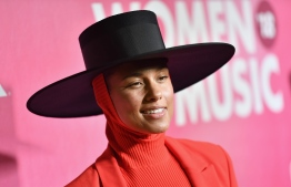 "(FILES) In this file photo taken on December 6, 2018 US musician Alicia Keys attends Billboard's 13th Annual Women In Music event at Pier 36 in New York City. - American singer and songwriter Alicia Keys will host the Grammy Awards next month, she announced on January 15, 2019, one year after the gala came under fire over diversity concerns. Keys -- herself a 15-time Grammy winner -- will be the emcee for music's biggest night, which this year features a diverse slate of women and hip hop artists as leading contenders. ""I know what it feels like to be on that stage, and I know what it feels like to be proud of the work that you've put in and to be recognized for it,"" Keys said in a video posted on social media.""I feel like it's the perfect opportunity for me to give the light back and lift people up -- especially all the young women that are nominated,"" she added. (Photo by Angela Weiss / AFP)"