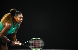 Serena Williams of the US prepares to return serve against Canada's Eugenie Bouchard during their women's singles match on day four of the Australian Open tennis tournament in Melbourne on January 17, 2019. (Photo by Jewel SAMAD / AFP) /