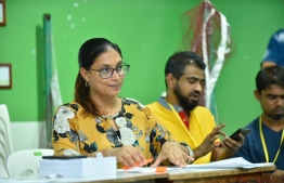 Minister of Education Aishath Ali as an election official during the Maldivian Democratic Party parliamentary primaries. PHOTO: NISHAN ALI/MIHAARU