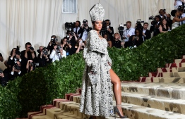 (FILES) In this file photo taken on May 8, 2018 Rihanna arrives for the 2018 Met Gala at the Metropolitan Museum of Art in New York. - Pop idol Rihanna is preparing to launch her own luxury brand with the world's biggest fashion conglomerate. According to Women's Wear Daily (WWD), Rihanna is in secret talks with the French giant LVMH. (Photo by Hector RETAMAL / AFP)
