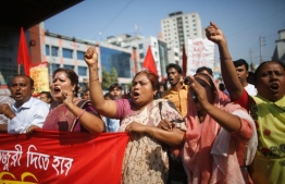Bangladeshi garment factory workers taking part in a protest. PHOTO: AL JAZEERA AMERICA