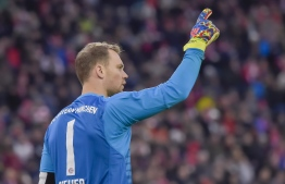 Bayern Munich's German keeper Manuel Neuer reacts during the German first division Bundesliga football match FC Bayern Munich vs VfB Stuttgart in the southern German city of Munich on January 27, 2019. (Photo by Guenter SCHIFFMANN / AFP)