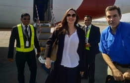 US actress and humanitarian Angelina Jolie, a special envoy for the United Nations High Commissioner for Refugees (UNHCR), arrives at the airport in Cox's Bazar in southern Bangladesh on February 4, 2019, ahead of a visit to nearby Rohingya refugee camps. - UNHCR Special Envoy Angelina Jolie is visiting the refugee camps for Rohingya communities in southern Bangladesh who have fled violence in neighbouring Myanmar. (Photo by STR / AFP)