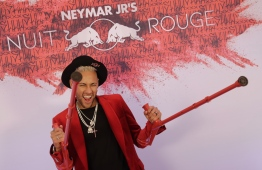Paris Saint-Germain's Brazilian forward Neymar poses with his crutches as he arrives at his birthday party in Paris on February 4, 2019. (Photo by Thomas SAMSON / AFP)