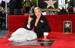 Recording artist Pink poses on her Hollywood Walk of Fame Star at a ceremony in Hollywood, California, on February 5, 2019. (Photo by Frederic J. BROWN / AFP)